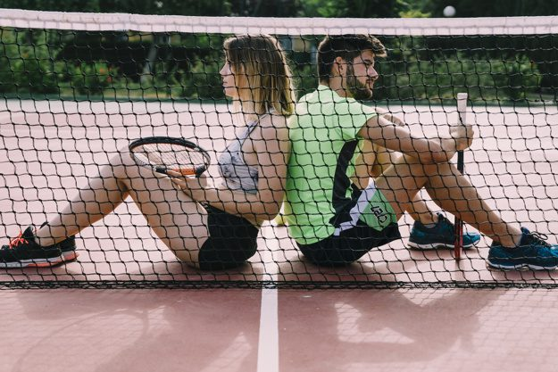 tennis elbow players taking a break by the net